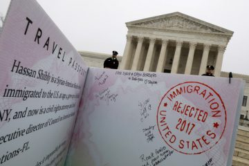 A mock-up of banned Muslim travellers' passport is placed outside the U.S. Supreme Court in Washington